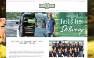 The home page of Brookside Barkery and Bath where they are advertising deliveries and below is an image of the entire staff