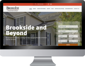 A mock-up design of Brookside Real Estate featured on an Apple computer